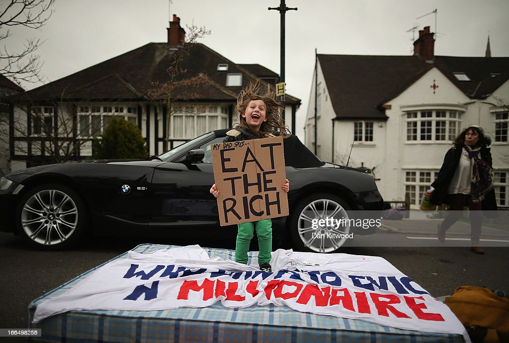 Eight-year-old Lucien Shalmy-Freeman bounces on a matress as UK UNCUT supporters protest over the government's changes to the welfare system and the proposed 'Bedroom Tax', on April 13, 2013 in London, England. The anti-austerity campaigners gathered outside the Highgate, North London, home of Lord Freud during a day of action, after they promised to target the home of a 'well-known millionaire.'