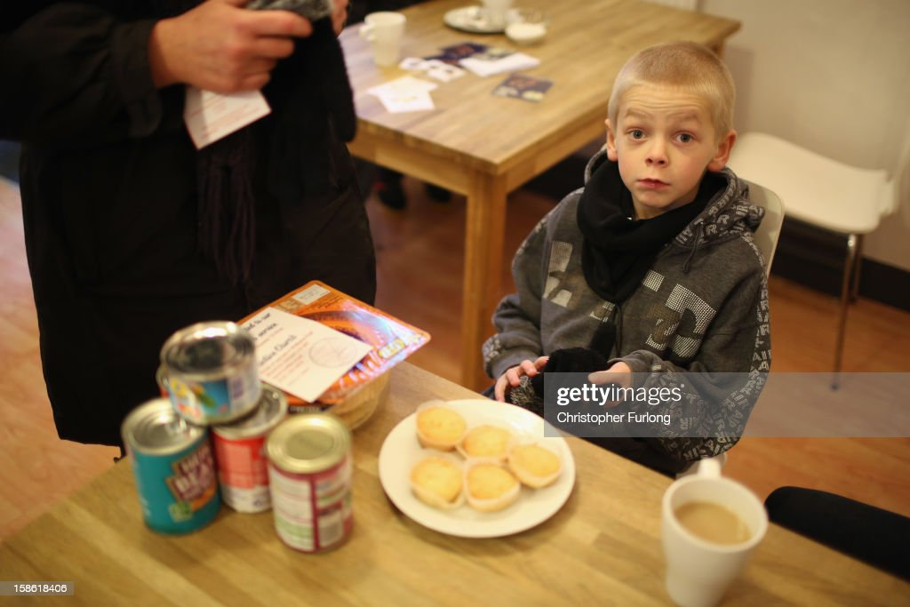 Eight-year-old Ryan Morris waits as his family collect food for Christmas at Liverpool Foodbank on December 21, 2012 in Liverpool, England. With Christmas only days away, volunteers at the Central Liverpool Foodbank at the Frontline Trust, have seen one of their busiest days of the year as they give out free food for the needy. The centre has been giving out festive treats as well as its normal food donation - feeding over 1000 individuals in its first year, including over 300 children.