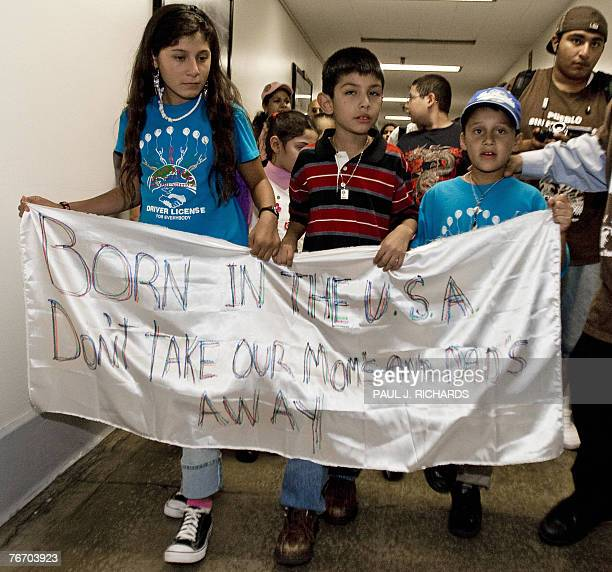 Eightyearold Saul Arellano marches in the halls of the Rayburn building on Capitol Hill in Washington 12 September 2007 following a press conference...
