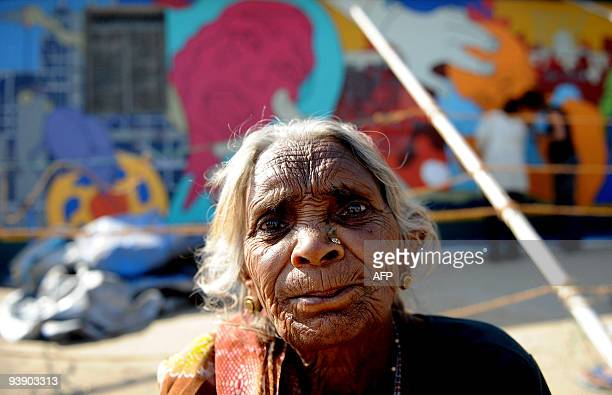 Eightyfour year old Indian woman Tarabai a survivor of the 1984 gas leak accident sits outside the boundary wall of the old Union Carbide factory in...