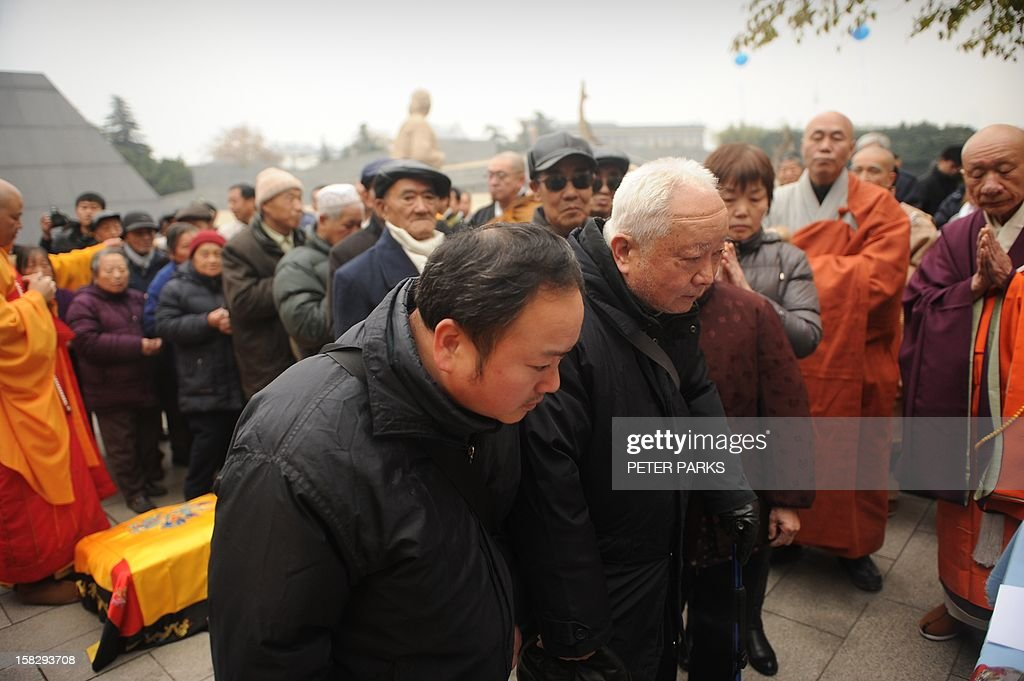 Eighty-seven-year-old Nanjing massacre survivor Li Zhong (centre R) pays his respects with other survivors and relatives to victims on the 75th anniversary of the Nanjing massacre at the Memorial Museum in Nanjing on December 13, 2012. Air raid sirens sounded in the Chinese city of Nanjing on December 13 as it marked the 75th anniversary of the mass killing and rape committed there by Japanese soldiers -- with the Asian powers' ties at a deep low. AFP PHOTO/Peter PARKS