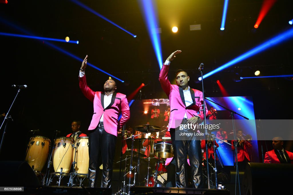 Eignar Renteria Serna and Willys del Arka of Orquesta Guayacan preform onstage during Viva La Salsa concert at James L. Knight Center on March 11, 2017 in Miami, Florida.