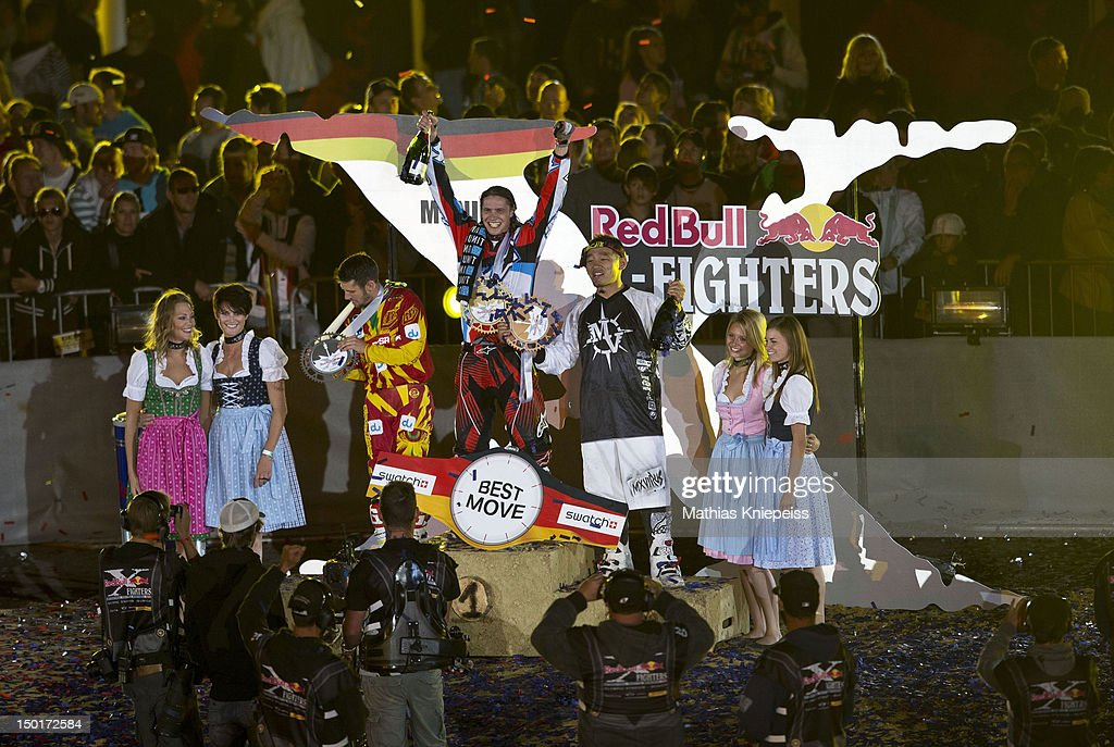 Eigo Sato of Japan, Thomas Pages of France and Dany Torres of Spain celebrate during the Red Bull X-Fighters World Tour at Olympia stadium on August 11, 2012 in Munich, Germany.