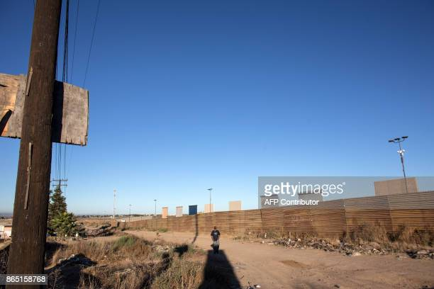 TOPSHOT Eigth prototypes of US President Donald Trump's USMexico border wall being built near San Diego in the US are seen from across the border...