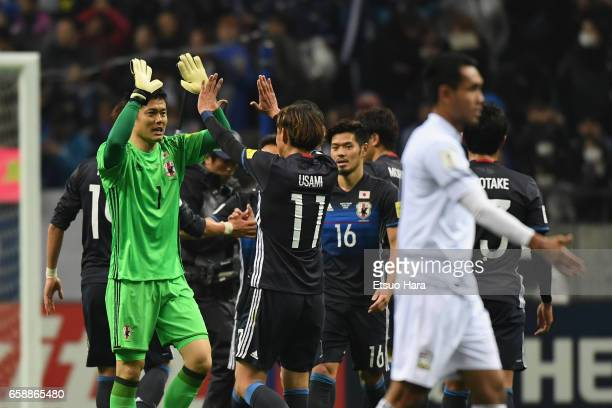 Eiji Kawashima and Takashi Usami of Japan celebrate after their 40 win in the 2018 FIFA World Cup Qualifier match between Japan and Thailand at...