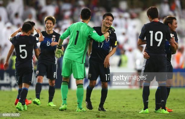 Eiji Kawashima and Yasuyuki Konno of Japan celebrate victory with team mates after the FIFA 2018 World Cup qualifying match between United Arab...