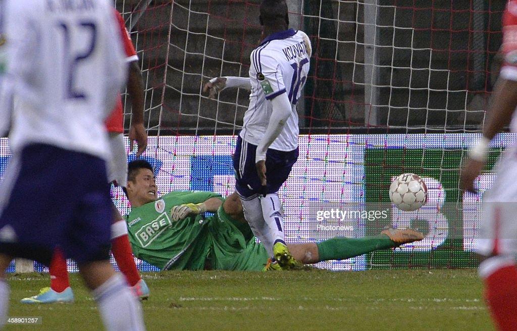 Eiji Kawashima goalkeeper of Standard Liege - Kouyate Cheikhou of Rsc Anderlecht during the Jupiler League match between Standard Liege and RSC Anderlecht on December 22, 2013 in Liege, Belgium.