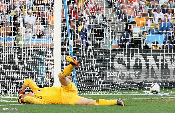 Eiji Kawashima is stunned as a shot from Wesley Sneijder of the Netherlands hits the back of the net during the 2010 FIFA World Cup South Africa...