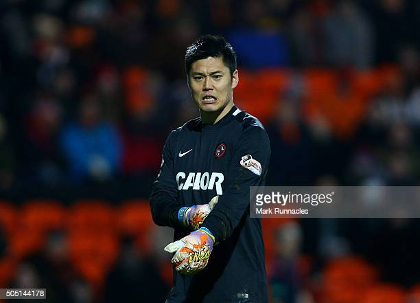 Eiji Kawashima of Dundee United walks back to his goal line after seeing his goal breached for the fourth time by a Kris Commons of Celtic...