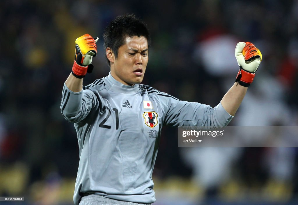 Eiji Kawashima of Japan celebrates the opening goal by Keisuke Honda during the 2010 FIFA World Cup South Africa Group E match between Denmark and...