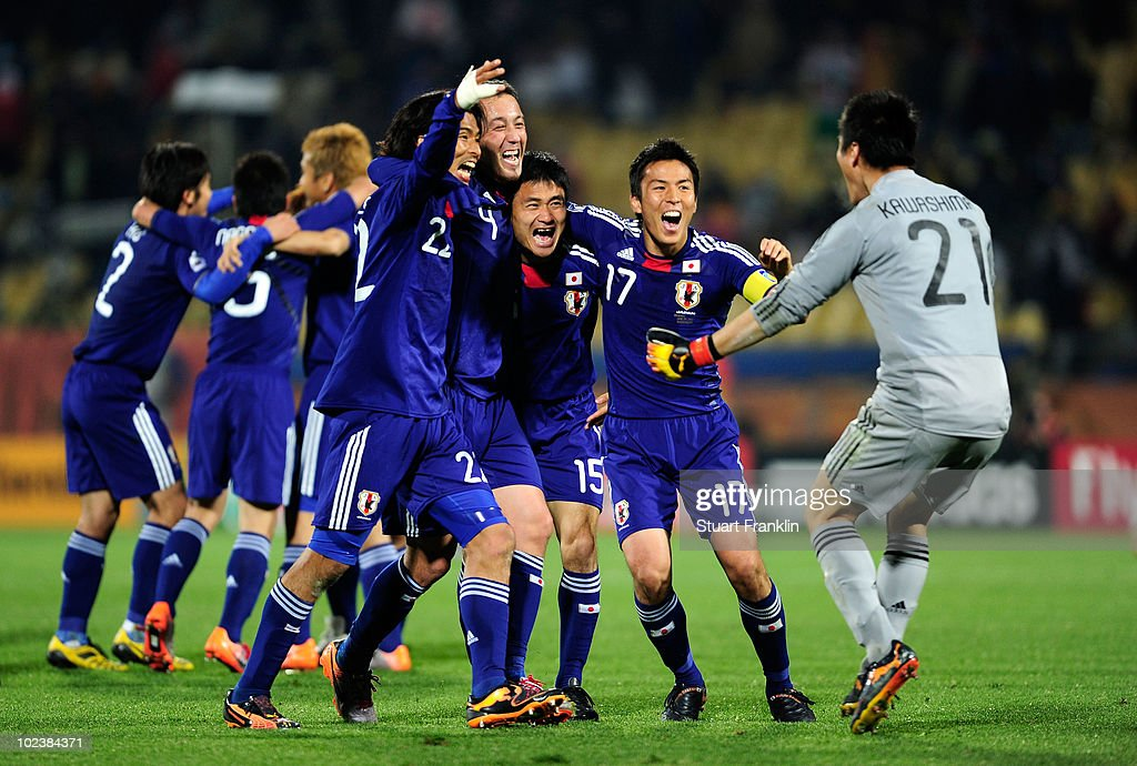 Eiji Kawashima of Japan celebrates victory with team mates following the 2010 FIFA World Cup South Africa Group E match between Denmark and Japan at...