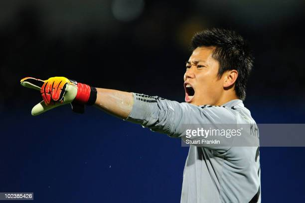 Eiji Kawashima of Japan directs his defence during the 2010 FIFA World Cup South Africa Group E match between Denmark and Japan at the Royal Bafokeng...