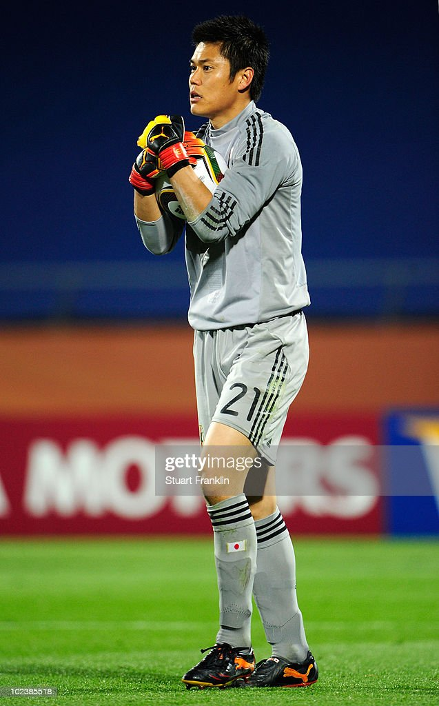 <a gi-track='captionPersonalityLinkClicked' href=/galleries/search?phrase=Eiji+Kawashima&family=editorial&specificpeople=3117136 ng-click='$event.stopPropagation()'>Eiji Kawashima</a> of Japan in action during the 2010 FIFA World Cup South Africa Group E match between Denmark and Japan at the Royal Bafokeng Stadium on June 24, 2010 in Rustenburg, South Africa.