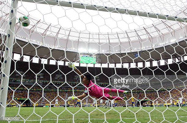 Eiji Kawashima of Japan is unable to stop Neymar of Brazil scoring his team's opening goal during the FIFA Confederations Cup Brazil 2013 Group A...