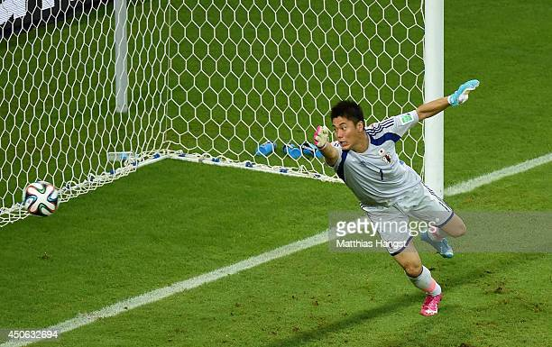 Eiji Kawashima of Japan watches as a header by Wilfried Bony of the Ivory Coast goes in for the Ivory Coast's first goal during the 2014 FIFA World...