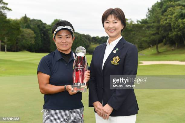 Eika Otake and the LPGA predident Hiromi Kobayashi of Japan pose with the trophy during the award ceremony of the LPGA Legends Champioship KRY Cup at...