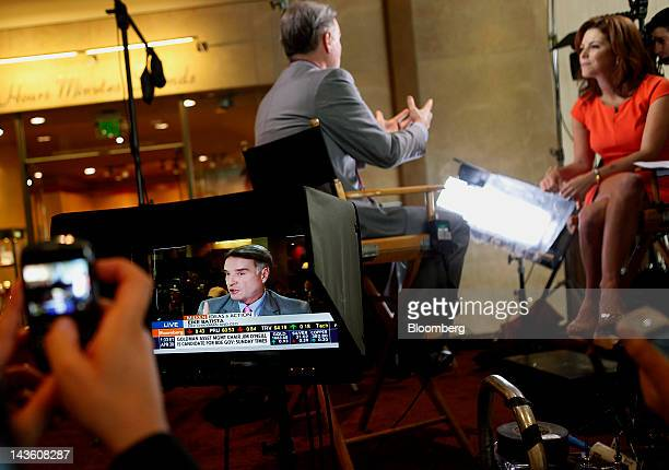 Eike Batista chief executive officer of EBX Group Co Ltd is seen on a monitor speaking during a Bloomberg Television interview at the annual Milken...
