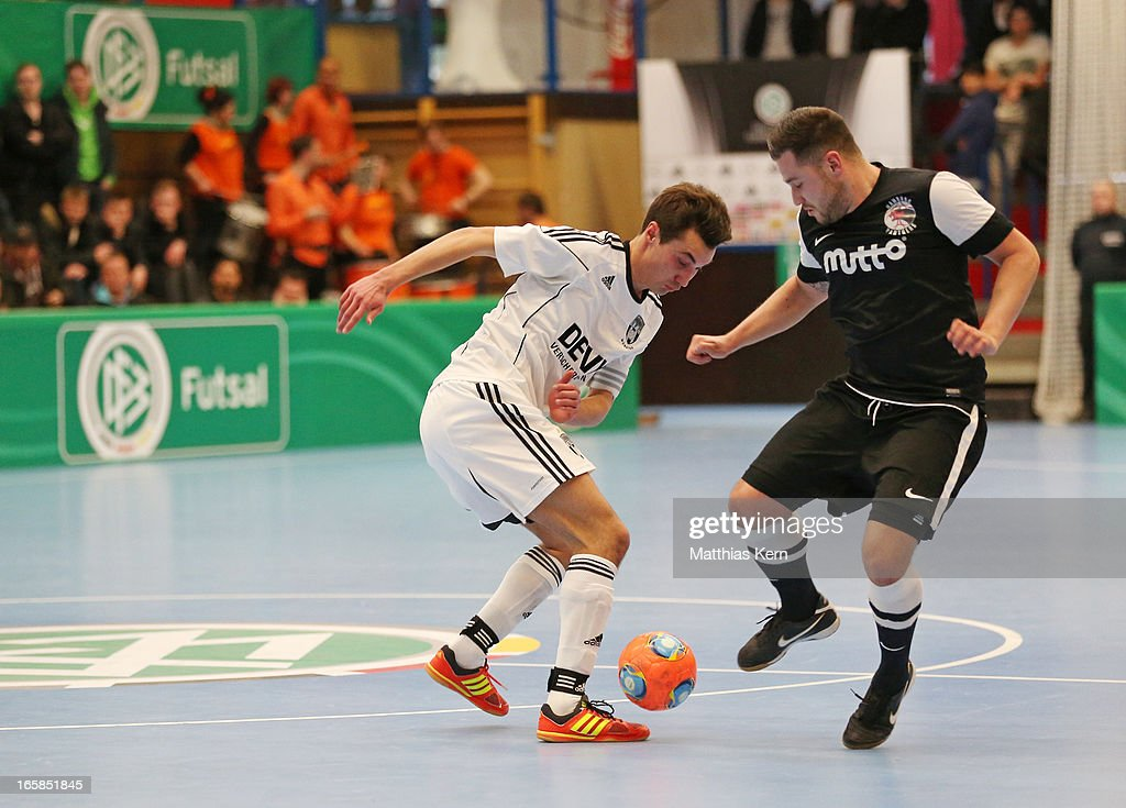 Eike Wessels (L) of Muenster battles for the ball with Carlos Rafael Ferreira Monteiro (R) of Hamburg during the DFB Futsal Cup final match between Hamburg Panthers and UFC Muenster at Sporthalle Wandsbek on April 6, 2013 in Hamburg, Germany.