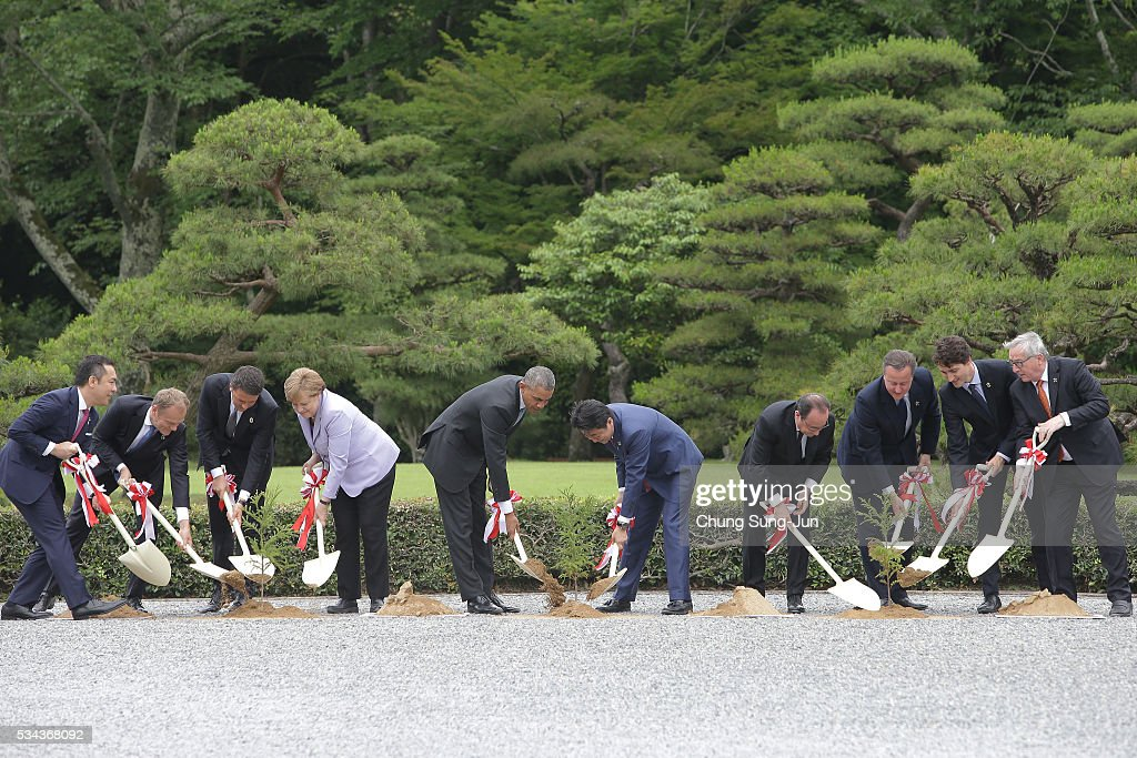 Eikei Suzuki, governor of Mie Prefecture, European Council President <a gi-track='captionPersonalityLinkClicked' href=/galleries/search?phrase=Donald+Tusk&family=editorial&specificpeople=870281 ng-click='$event.stopPropagation()'>Donald Tusk</a>, Italian Prime Minister <a gi-track='captionPersonalityLinkClicked' href=/galleries/search?phrase=Matteo+Renzi&family=editorial&specificpeople=6689301 ng-click='$event.stopPropagation()'>Matteo Renzi</a>, German Chancellor <a gi-track='captionPersonalityLinkClicked' href=/galleries/search?phrase=Angela+Merkel&family=editorial&specificpeople=202161 ng-click='$event.stopPropagation()'>Angela Merkel</a>, U.S. President <a gi-track='captionPersonalityLinkClicked' href=/galleries/search?phrase=Barack+Obama&family=editorial&specificpeople=203260 ng-click='$event.stopPropagation()'>Barack Obama</a>, Japanese Prime Minister <a gi-track='captionPersonalityLinkClicked' href=/galleries/search?phrase=Shinzo+Abe&family=editorial&specificpeople=559017 ng-click='$event.stopPropagation()'>Shinzo Abe</a>, French President Francois Hollande, British Prime Minister <a gi-track='captionPersonalityLinkClicked' href=/galleries/search?phrase=David+Cameron+-+Homme+politique&family=editorial&specificpeople=227076 ng-click='$event.stopPropagation()'>David Cameron</a>, Canadian Prime Minister <a gi-track='captionPersonalityLinkClicked' href=/galleries/search?phrase=Justin+Trudeau&family=editorial&specificpeople=2616495 ng-click='$event.stopPropagation()'>Justin Trudeau</a> and European Commission President <a gi-track='captionPersonalityLinkClicked' href=/galleries/search?phrase=Jean-Claude+Juncker&family=editorial&specificpeople=207032 ng-click='$event.stopPropagation()'>Jean-Claude Juncker</a>, participate in a tree planting during a visit at Ise Jingu Shrine on May 26, 2016 in Kashikojima, Japan. In the two-day summit, the G7 leaders are scheduled to discuss the pressing global issues including counter-terrorism, energy policy, and sustainable development.