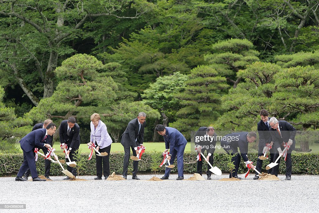 Eikei Suzuki, governor of Mie Prefecture, European Council President Donald Tusk, Italian Prime Minister Matteo Renzi, German Chancellor Angela Merkel, U.S. President Barack Obama, Japanese Prime Minister Shinzo Abe, French President Francois Hollande, British Prime Minister David Cameron, Canadian Prime Minister Justin Trudeau and European Commission President Jean-Claude Juncker, participate in a tree planting during a visit at Ise Jingu Shrine on May 26, 2016 in Kashikojima, Japan. In the two-day summit, the G7 leaders are scheduled to discuss the pressing global issues including counter-terrorism, energy policy, and sustainable development.