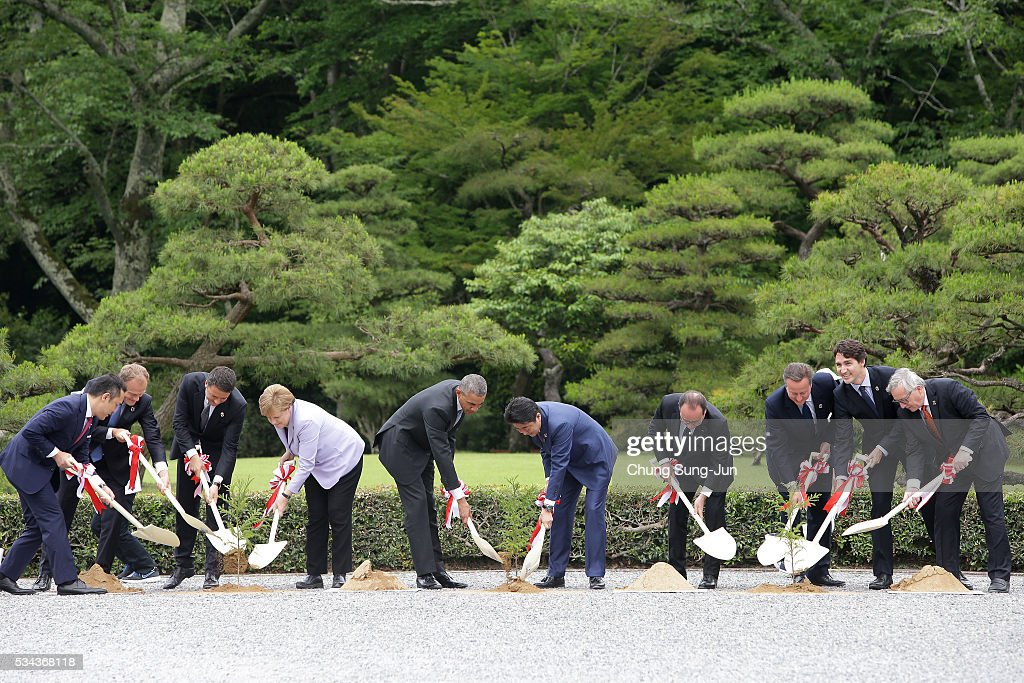 Eikei Suzuki, governor of Mie Prefecture, European Council President <a gi-track='captionPersonalityLinkClicked' href=/galleries/search?phrase=Donald+Tusk&family=editorial&specificpeople=870281 ng-click='$event.stopPropagation()'>Donald Tusk</a>, Italian Prime Minister <a gi-track='captionPersonalityLinkClicked' href=/galleries/search?phrase=Matteo+Renzi&family=editorial&specificpeople=6689301 ng-click='$event.stopPropagation()'>Matteo Renzi</a>, German Chancellor <a gi-track='captionPersonalityLinkClicked' href=/galleries/search?phrase=Angela+Merkel&family=editorial&specificpeople=202161 ng-click='$event.stopPropagation()'>Angela Merkel</a>, U.S. President <a gi-track='captionPersonalityLinkClicked' href=/galleries/search?phrase=Barack+Obama&family=editorial&specificpeople=203260 ng-click='$event.stopPropagation()'>Barack Obama</a>, Japanese Prime Minister <a gi-track='captionPersonalityLinkClicked' href=/galleries/search?phrase=Shinzo+Abe&family=editorial&specificpeople=559017 ng-click='$event.stopPropagation()'>Shinzo Abe</a>, French President Francois Hollande, British Prime Minister <a gi-track='captionPersonalityLinkClicked' href=/galleries/search?phrase=David+Cameron+-+Politician&family=editorial&specificpeople=227076 ng-click='$event.stopPropagation()'>David Cameron</a>, Canadian Prime Minister <a gi-track='captionPersonalityLinkClicked' href=/galleries/search?phrase=Justin+Trudeau&family=editorial&specificpeople=2616495 ng-click='$event.stopPropagation()'>Justin Trudeau</a> and European Commission President <a gi-track='captionPersonalityLinkClicked' href=/galleries/search?phrase=Jean-Claude+Juncker&family=editorial&specificpeople=207032 ng-click='$event.stopPropagation()'>Jean-Claude Juncker</a>, participate in a tree planting during a visit at Ise Jingu Shrine on May 26, 2016 in Kashikojima, Japan. In the two-day summit, the G7 leaders are scheduled to discuss the pressing global issues including counter-terrorism, energy policy, and sustainable development.