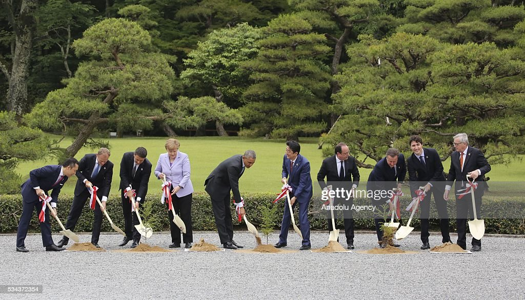 Eikei Suzuki, governor of Mie Prefecture, European Council President Donald Tusk, Italian Prime Minister Matteo Renzi, German Chancellor Angela Merkel, US President Barack Obama, Japanese Prime Minister Shinzo Abe, French President Francois Hollande, British Prime Minister David Cameron, Canadian Prime Minister Justin Trudeau and European Commission President Jean-Claude Juncker participate to the tree planting ceremony at Ise-Jingu Shrine during the first day of the G7 leaders summit in the city of Ise in Mie prefecture, Japan on May 26, 2016.