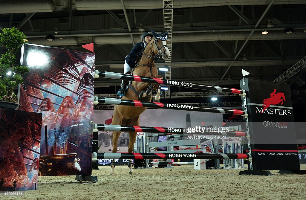 Eiken Sato riding Espyrante competes in the international jumping competition Grand Prix equestrian event in Hong Kong on March 2, 2013. AFP PHOTO / Antony DICKSON