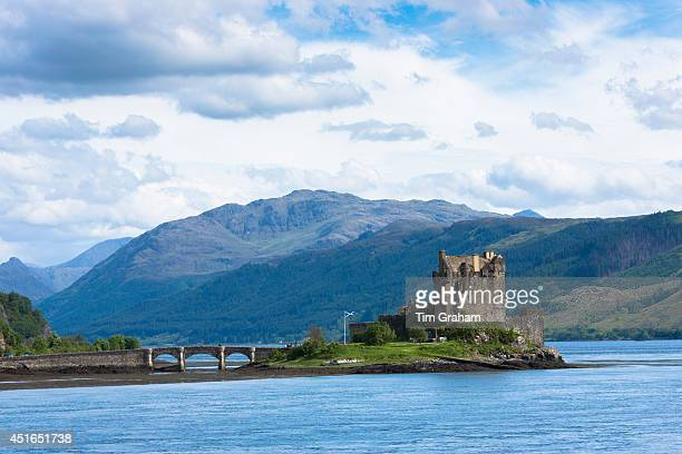 Eilean Donan Castle a highland fortress with Saltire Scottish flag flying in Loch Alshe at Dornie Kyle of Lochalse in the western hIghlands of...
