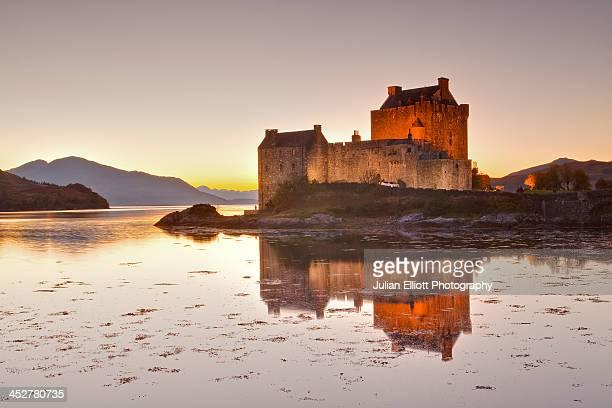 Eilean Donan castle reflecting in Loch Duich.