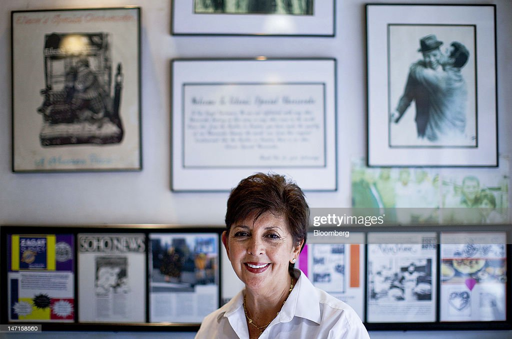 Eileen Avezzano, owner of Eileen's Special Cheese Cake, sits for a photograph in New York, U.S., on Monday, June 25, 2012. Avezzano says she has a better way than Groupon Inc.'s online deals to entice customers to buy her cheesecakes again: She doles out loyalty cards that reward buyers for return visits. Photographer: Jin Lee/Bloomberg via Getty Images