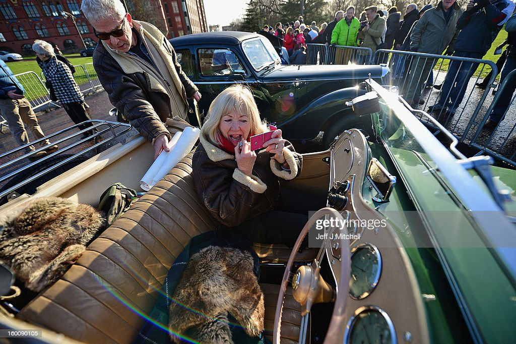 Eileen Pisaneschi puts lipstick as she sits in a MGTD ahead of the start of the Monte Carlo Classic Rally on January 26, 2013 in Glasgow. Around 100 cars will set off from The People's Palace at Glasgow Green, they will pass through Kilmarnock and Dumfries on route to Monte Carlo via Dover.