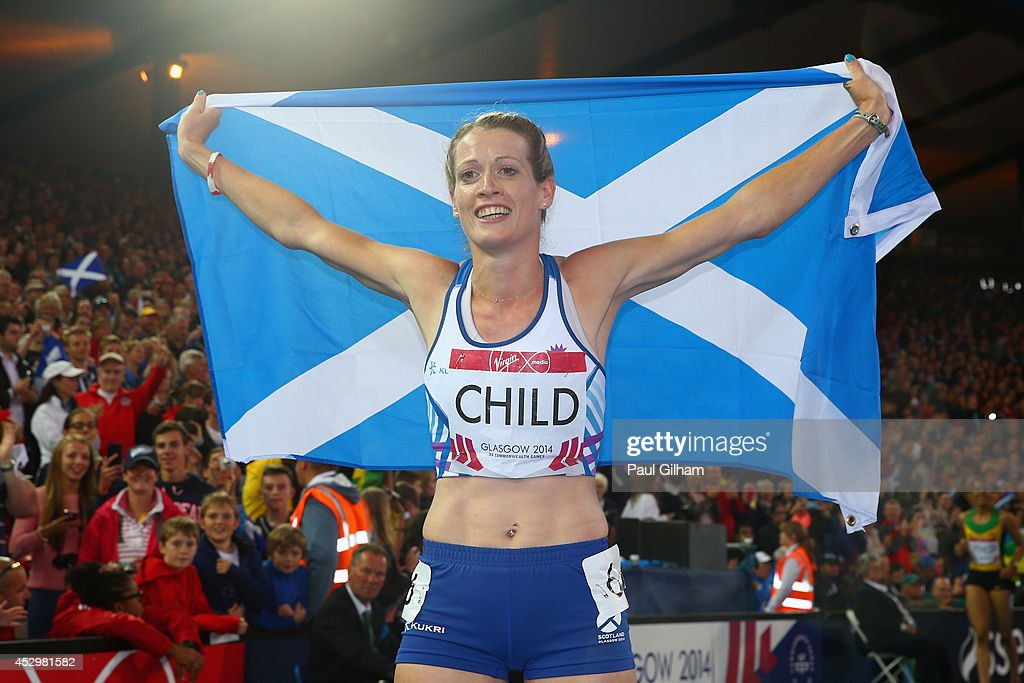 Eilidh Child of Scotland celebrates winning silver in the Women's 400 metres hurdles final at Hampden Park during day eight of the Glasgow 2014...