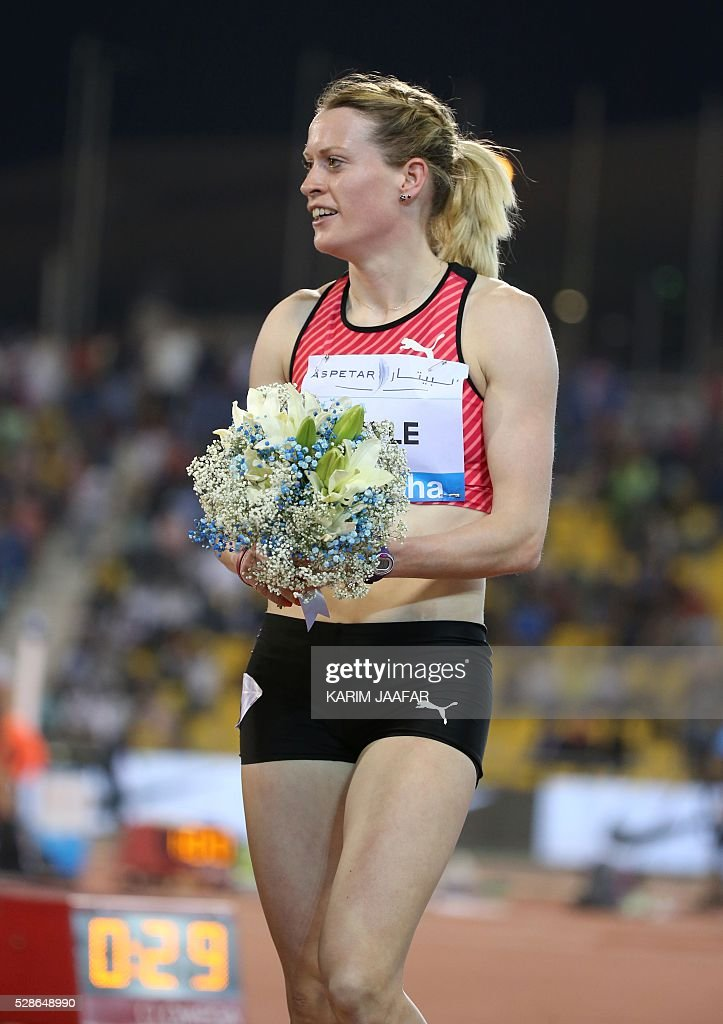 Eilidh Doyle of Great Britain celebrates after winning the women's 400 metres hurdles final at the Diamond League athletics meeting at the Suhaim bin Hamad Stadium in Doha on May 6, 2016. / AFP / KARIM