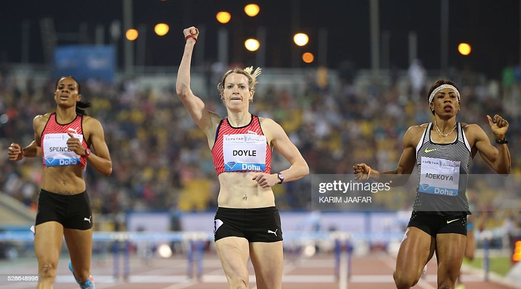 Eilidh Doyle (C) of Great Britain celebrates as she crosses the finish line to win the women's 400 metres hurdles final as Bahrain's Kemi Adejoya (R) comes in second place and Jamaica's Kaliese Spencer in third place at the Diamond League athletics meeting at the Suhaim bin Hamad Stadium in Doha on May 6, 2016. / AFP / KARIM