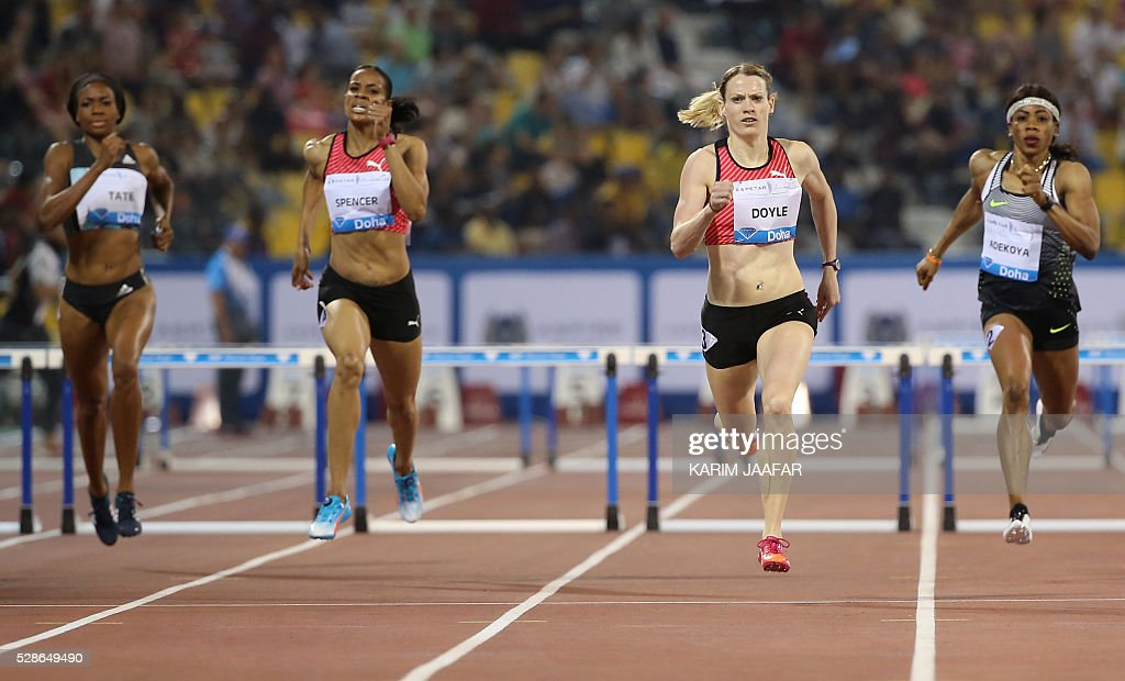 Eilidh Doyle (2R) of Great Britain celebrates (2R) runs win the women's 400 metres hurdles final as Bahrain's Kemi Adejoya (R) comes in second place and Jamaica's Kaliese Spencer (2L) in third place and America's Cassandra Tate in fifth place at the Diamond League athletics meeting at the Suhaim bin Hamad Stadium in Doha on May 6, 2016. / AFP / KARIM