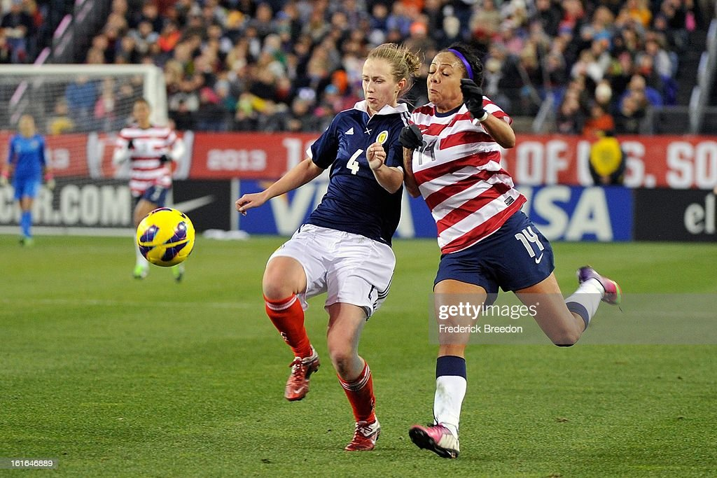 Eilish McSorley #4 of the Scotland Women's National Team plays against <a gi-track='captionPersonalityLinkClicked' href=/galleries/search?phrase=Sydney+Leroux&family=editorial&specificpeople=5760664 ng-click='$event.stopPropagation()'>Sydney Leroux</a> #14 of the U.S. Women's National Team at LP Field on February 13, 2013 in Nashville, Tennessee.