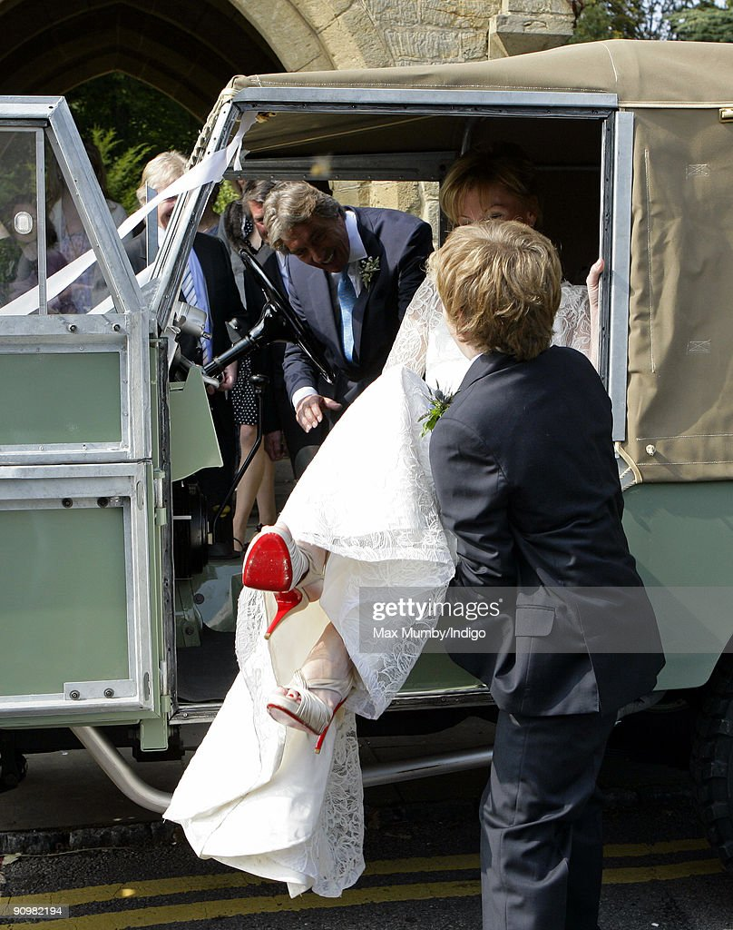 Eimear Montgomerie (ex-wife of golfer Colin Montgomerie) is helped into a canvas roofed Land Rover as she leaves St. Nicholas Church after her wedding to Nick Cook on September 20, 2009 in Cranleigh, England.