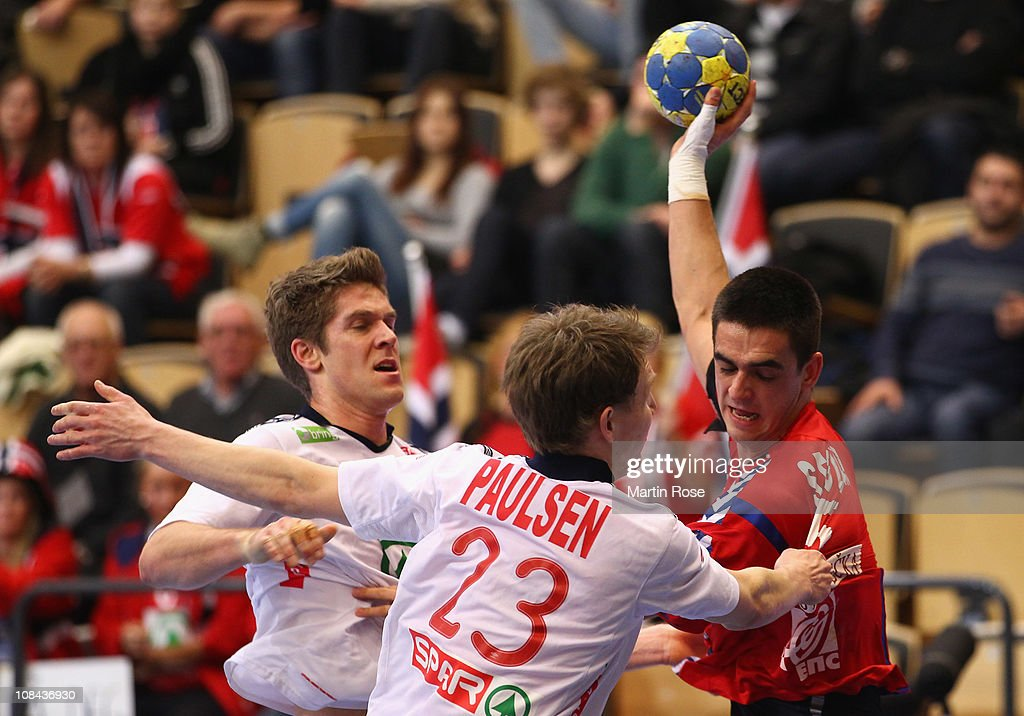 Einar Koren (L) and Sondre Paulsen (C) of Norway are challenged by Zarko Sesum (R) of Serbia during the Men's Handball World Championship placement match between Norway and Serbia at Kristianstad Arena on January 27, 2011 in Kristianstad, Sweden.