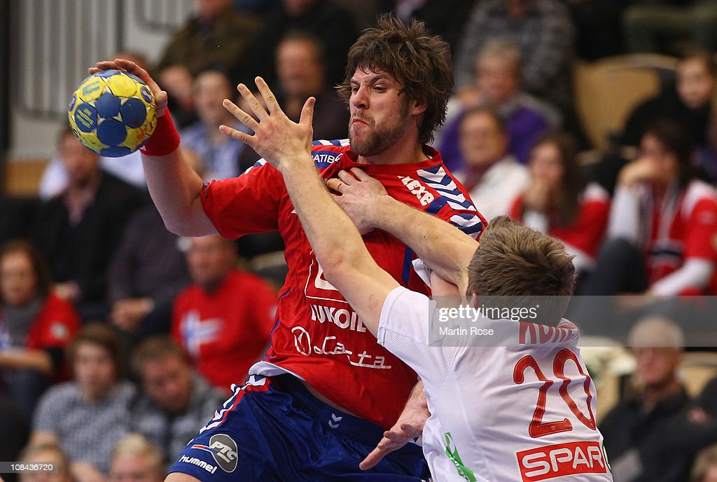 Einar Koren (R) of Norway is challenged by Momir Rnic (L) of Serbia during the Men's Handball World Championship placement match between Norway and Serbia at Kristianstad Arena on January 27, 2011 in Kristianstad, Sweden.