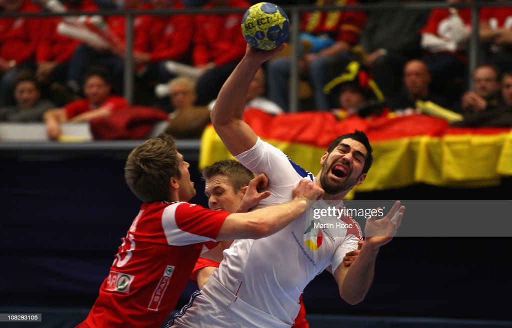 Einar Koren (L) of Norway is challenged by Nikola Karabatic (R) of France during the Men's Handball World Championship main round group I match between Norway and France at Kinnarps Arena on January 24, 2011 in Jonkoping, Sweden.