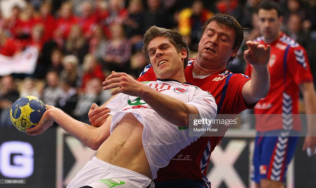 Einar Koren (L) of Norway is challenged by Rastko Stojkovic (R) of Serbia during the Men's Handball World Championship placement match between Norway and Serbia at Kristianstad Arena on January 27, 2011 in Kristianstad, Sweden.