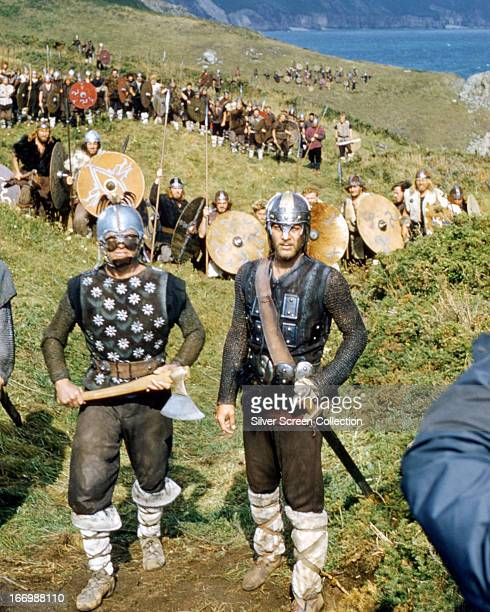 Einar played by American actor Kirk Douglas leads his warriors armed with a battleaxe in a publicity still for Richard Fleischer's 'The Vikings'...
