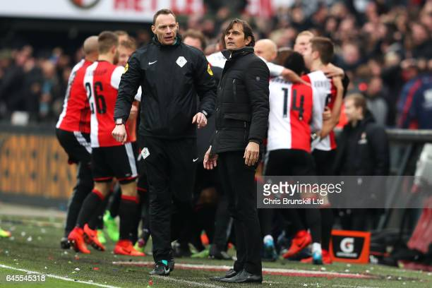 Eindhoven coach Phillip Cocu looks on as Feyenoord celebrate the winning goal during the Dutch Eredivisie match between Feyenoord and PSV Eindhoven...