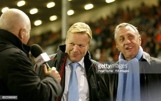 PSV Eindhoven manager Ronald Koeman and Johan Cruyff get interviewed before the game