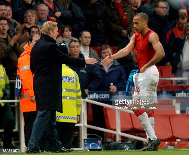 PSV Eindhoven manager Ronald Koeman shakes hands with Arsenal's Thierry Henry after the match