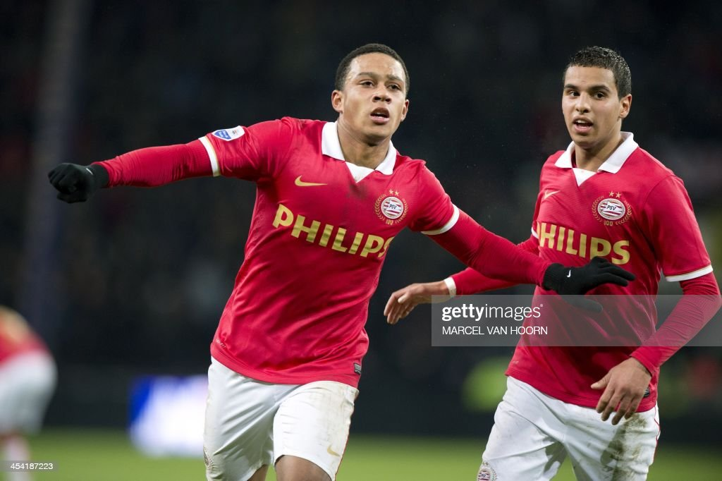 PSV Eindhoven player Memphis Depay (L) celebrates scoring an equalizing goal with teammate Adam Maher (R) during the Dutch Eredivisie soccer match between PSV Eindhoven and Vitesse Arnhem in Eindho...