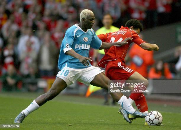 PSV Eindhoven's Arouna Kone fouls Liverpool's Jermaine Pennant as they battle for the ball