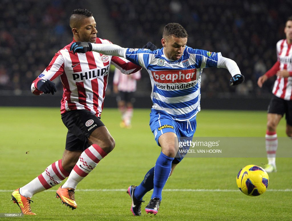 PSV Eindhoven's Dutch forward Jeremain Lens (L) vies with PEC Zwolle's Moroccan midfielder Rochdi Achenteh during the Dutch Eredivisie football match PSV Eindhoven vs PEC Zwolle in Eindhoven, on January 18, 2013. AFP PHOTO / ANP / MARCEL VAN HOORN netherlands out