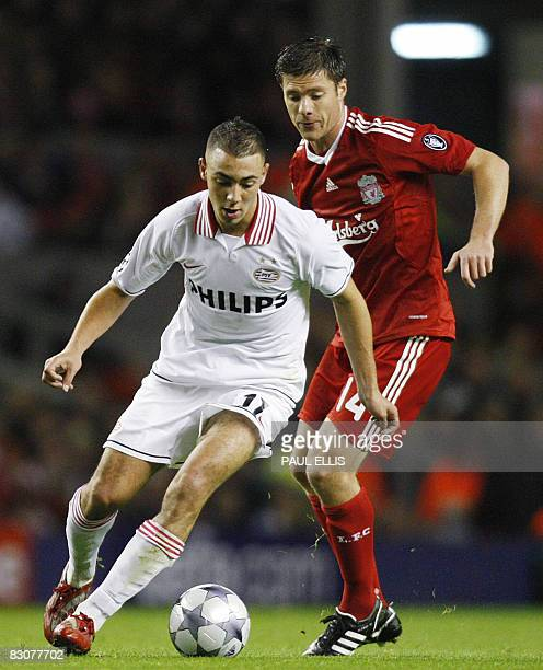 PSV Eindhoven's Dutch forward Nordin Amrabat holds the ball from Liverpool's Spanish midfielder Xabi Alonso during their UEFA Champions League...
