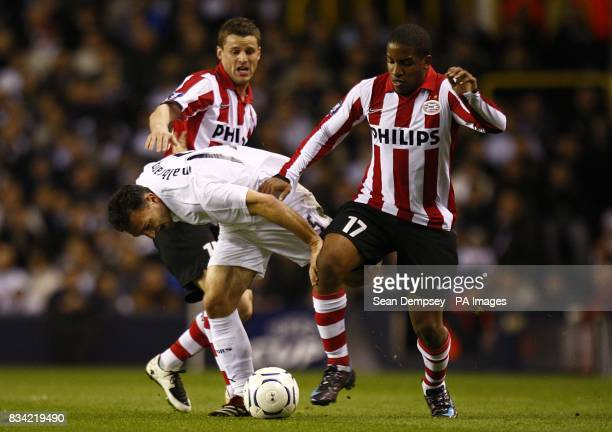 PSV Eindhoven's Jason Culina and Jefferson Farfan try to steal the ball from Tottenham Hotspur's Steed Malbranque